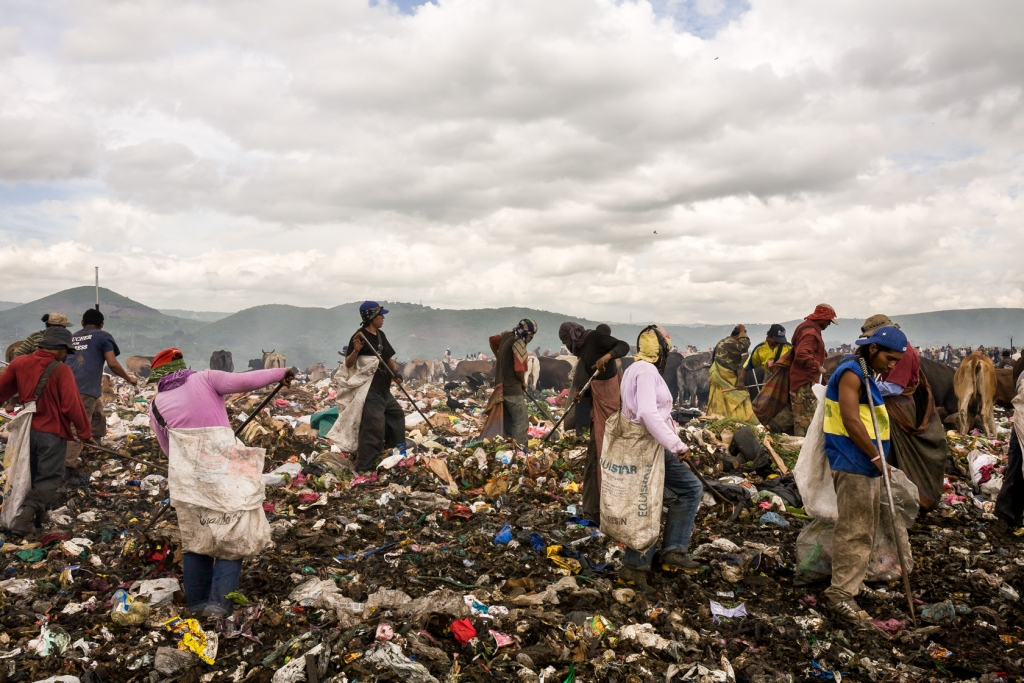 People sort out valuable trash at the municipal waste disposal site La Chureca in Managua.