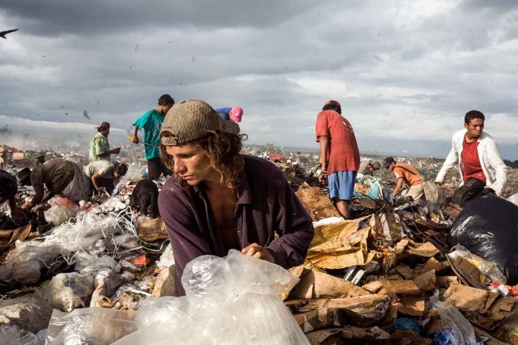 A young lad shifts through the rubbish at La Chureca city dump.