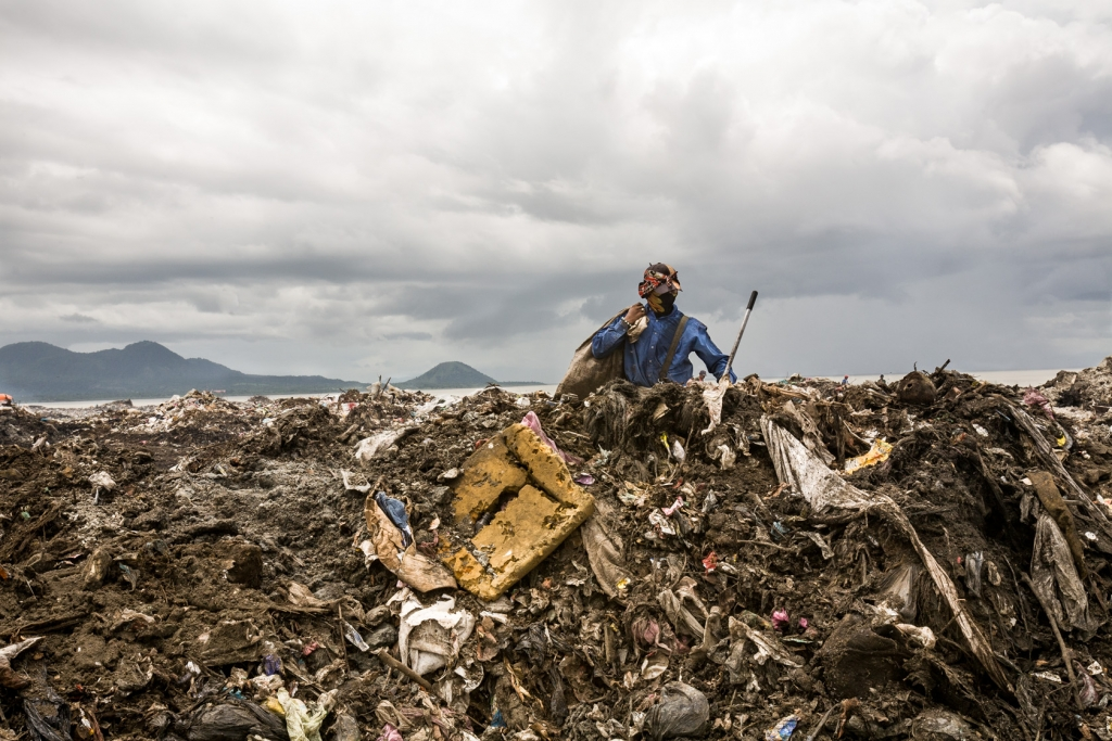 A young scavenger picking through refuse at the municipal garbage dump of Managua.