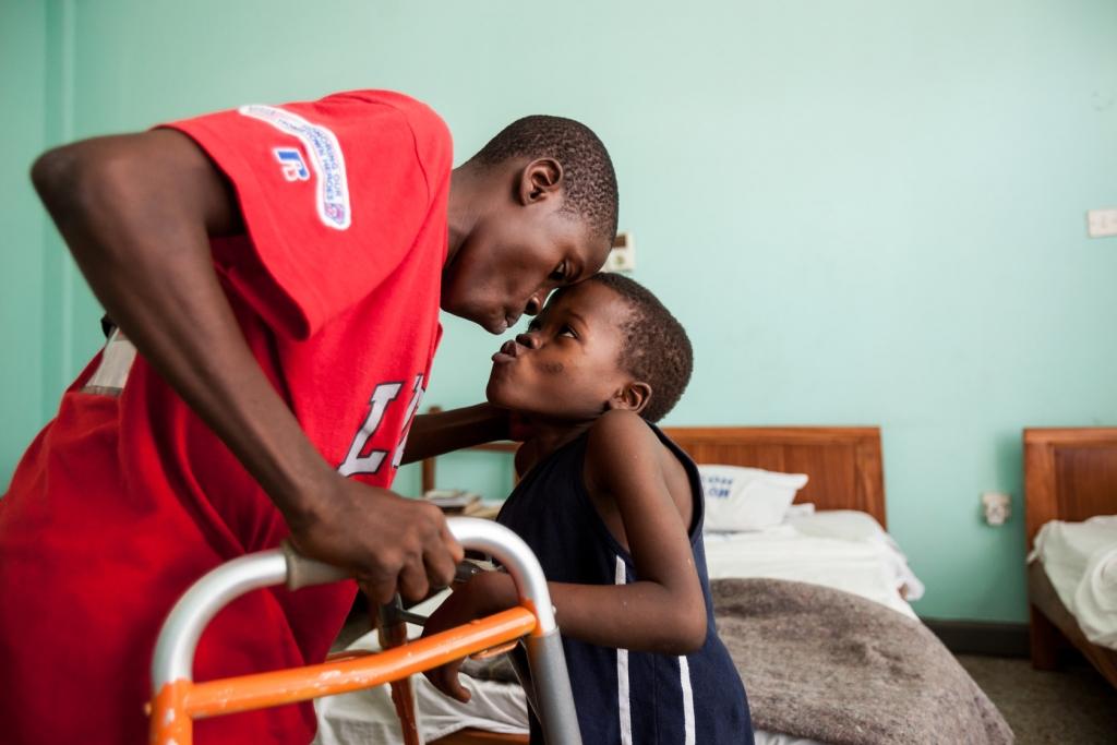 Jusu Moseray (right), six years old, bide a fond farewell to Gbassay Kanu.
