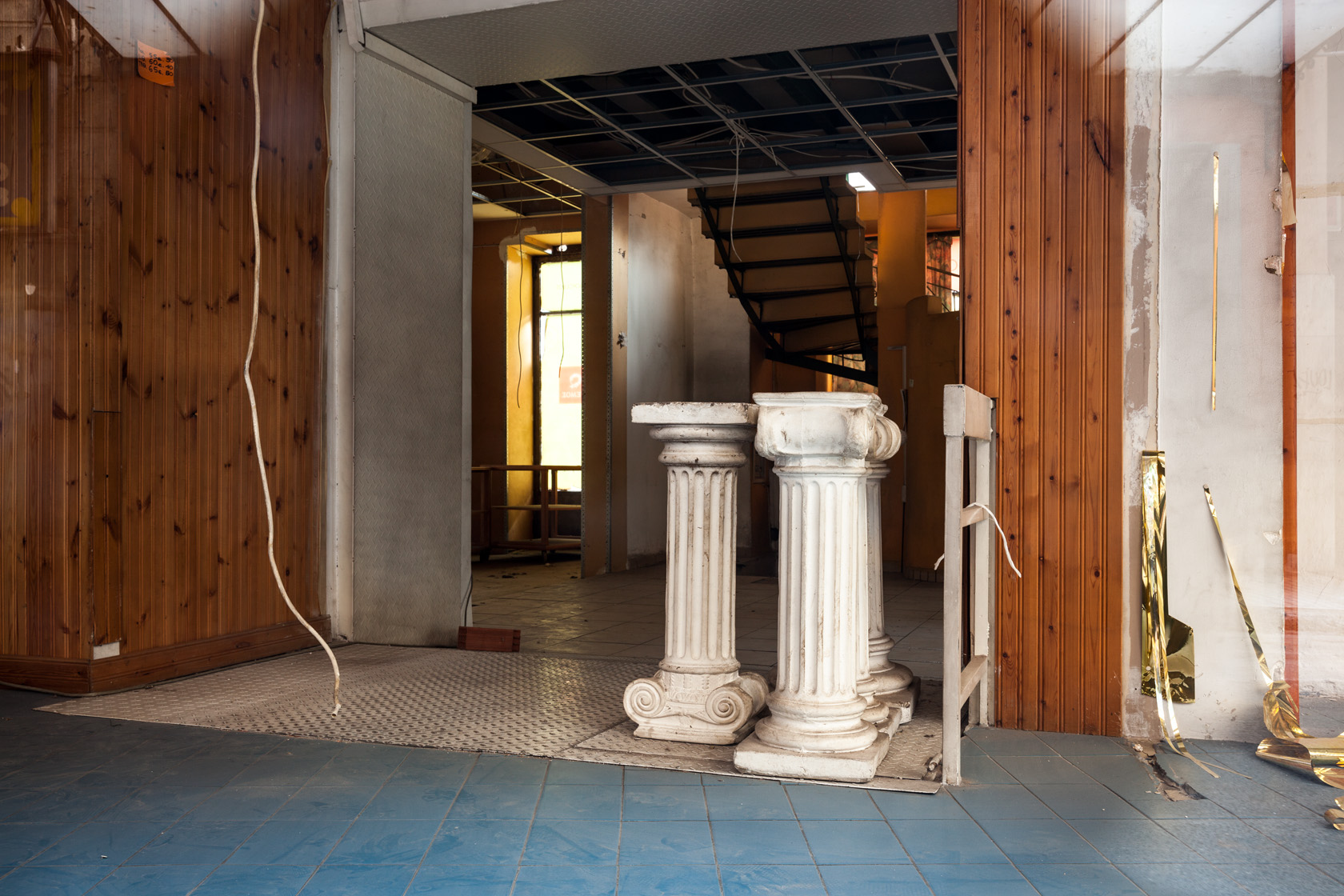 Columns that used to be part of the storefront decoration of a shop in central Athens.