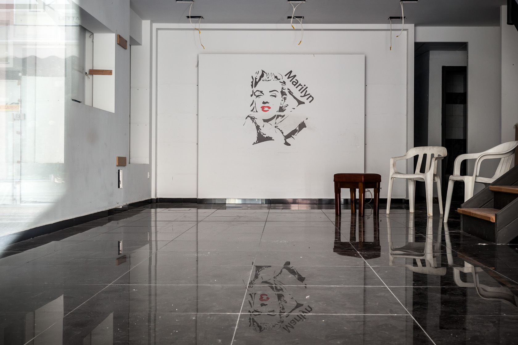 Drawing of Marilyn Monroe on the wall of a closed clothing shop in Amaliada, Greece.