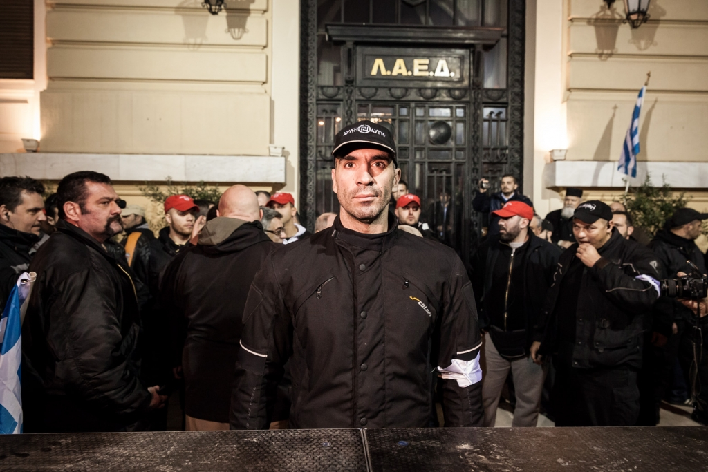 Members and supporters of the Greek ultra nationalist Golden Dawn party during a meeting in central Athens.