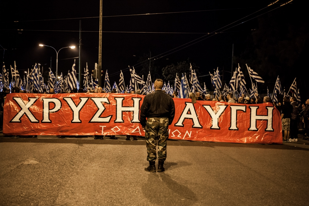 Supporters of ultra nationalist party Golden Dawn wave Greek flags and shout slogans as they demonstrate.
